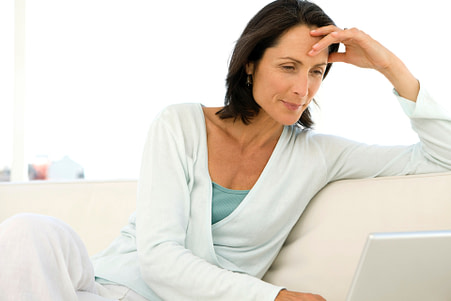 Woman working online with laptop
